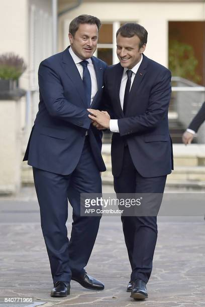 French President Emmanuel Macron meets with Luxembourg's Prime Minister Xavier Bettel at Senningen Castle in Luxembourg on August 29 2017 / AFP PHOTO...
