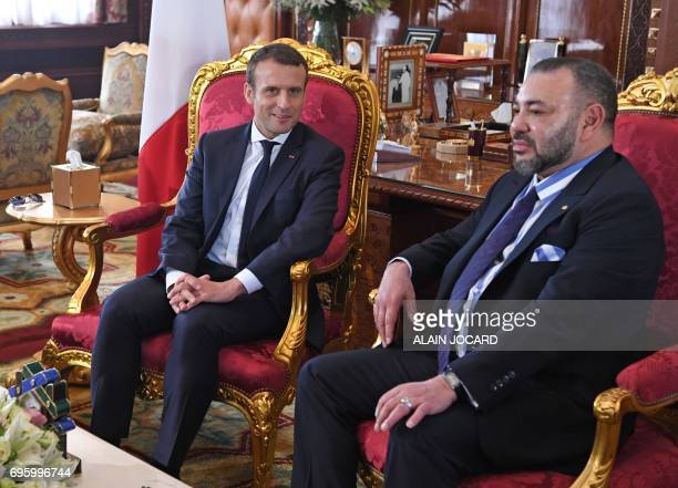 French President Emmanuel Macron meets with Moroccan King Mohammed VI at the Royal Palace in Rabat on June 14 2017 Macron is on an official visit to...