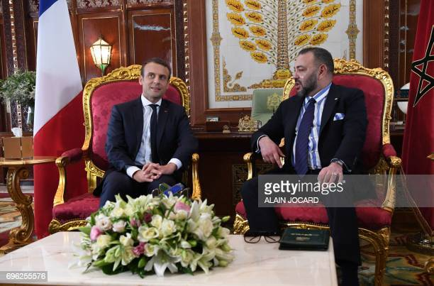 French President Emmanuel Macron meets with Moroccan King Mohammed VI at the Royal Palace in Rabat on June 14 2017 / AFP PHOTO / POOL AND AFP PHOTO /...