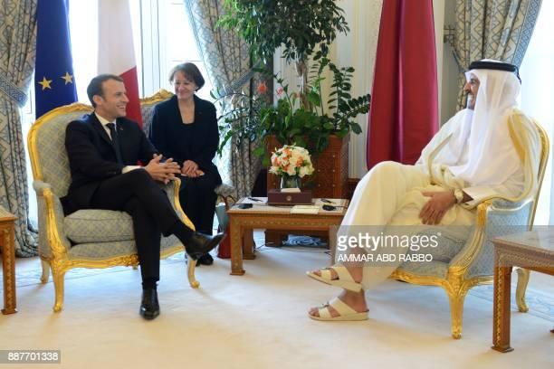 French President Emmanuel Macron meets with Qatari Emir Sheikh Tamim bin Hamad alThani in Doha on December 7 2017 / AFP PHOTO / POOL / Ammar ABD RABBO