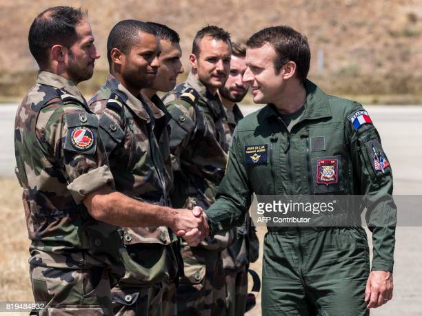 French President Emmanuel Macron meets with troops during a visit to the French air force base BA 125 in Istres southeastern France on July 20 2017 /...