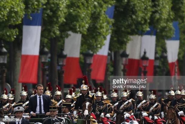 French President Emmanuel Macron parades in a car on the Champs Elysees avenue after his formal inauguration ceremony as French President on May 14...