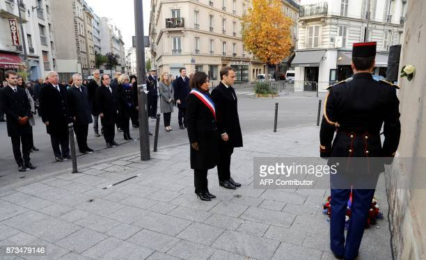 French President Emmanuel Macron Paris mayor Anne Hidalgo and Paris vicemayor Bruno Julliard French Senate speaker Gerard Larcher French National...