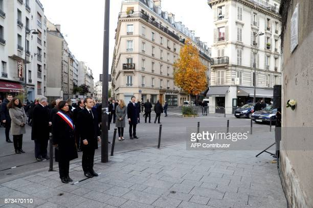 French President Emmanuel Macron Paris mayor Anne Hidalgo former French President Francois Hollande French Justice Minister Nicole Belloubet and...