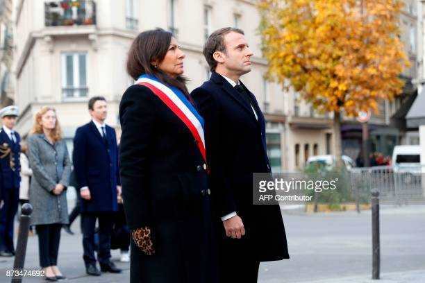French President Emmanuel Macron Paris mayor Anne Hidalgo French Justice Minister Nicole Belloubet and French Junior Minister for Finance Benjamin...