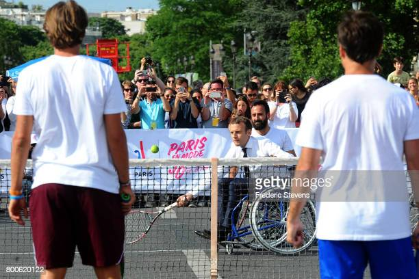 French President Emmanuel Macron plays tennis sitting in a wheelchair with Michael Jeremiasz and Lucas Pouille and Fabrice Santoro on Alexandre III...