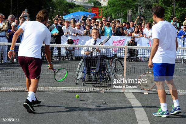 French President Emmanuel Macron plays tennis sitting in a wheelchair and Lucas Pouille and Fabrice Santoro on Alexandre III bridge as Paris promotes...