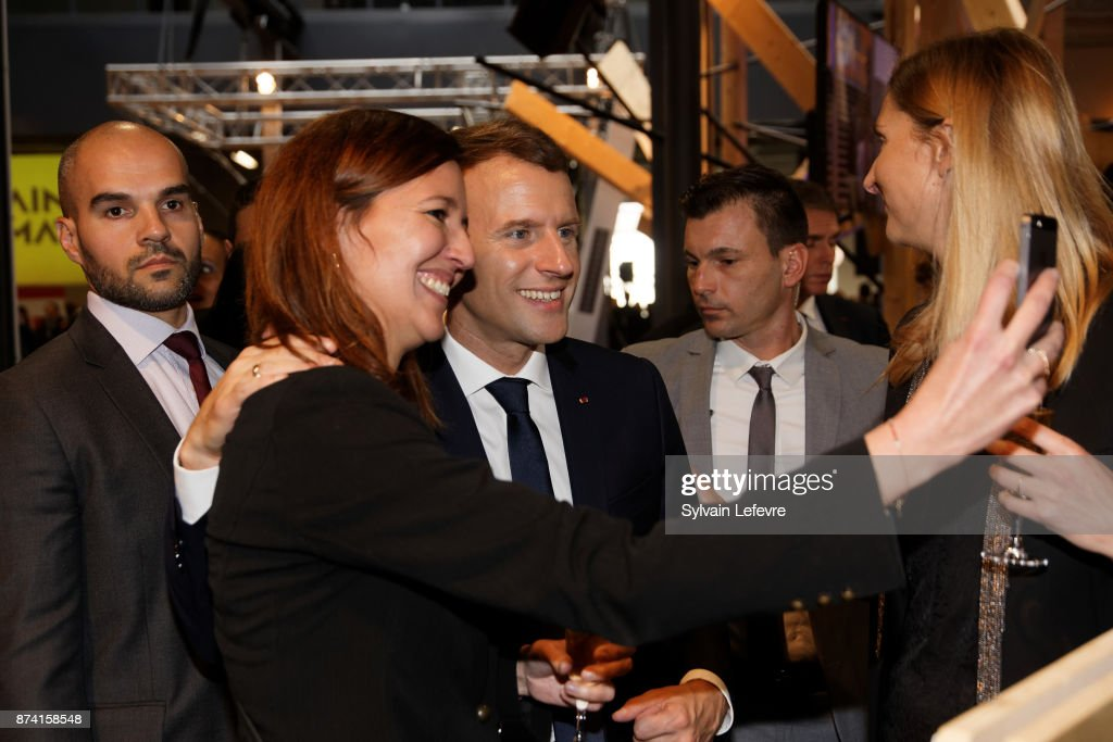 French President Emmanuel Macron poses for selfies with guests after delivering a speech during a visit to the Plaine Images industry hub on November 14, 2017 in Tourcoing, France.
