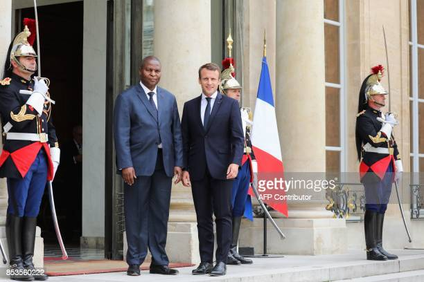 French president Emmanuel Macron poses with Central African Republic's president FaustinArchange Touadera upon his arrival for their meeting at the...