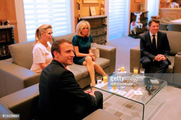 French President Emmanuel Macron poses with his wife Brigitte Nice mayor Christian Estrosi and his pregnant wife Laura Tenoudji after arriving in...