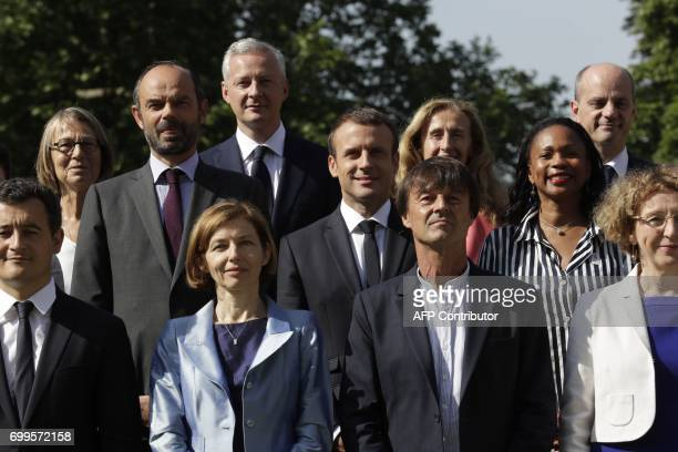 French president Emmanuel Macron poses with members of the governement Minister of Culture Francoise Nyssen Prime Minister Edouard Philippe French...