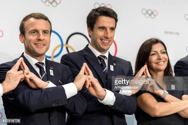 French President Emmanuel Macron poses with Paris 2024 Olympic bid copresident Tony Estanguet and Mayor of Paris Anne Hidalgo after the Paris 2014...