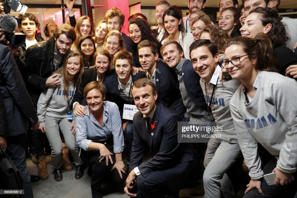 French President Emmanuel Macron (C- bottom) poses with participants of the 'Tech for Planet' event at the 'Station F' start up campus in Paris, on December 12, 2017, ahead of the One Planet Summit. ?The French President hosts 50 world leaders for the 'One Planet Summit', hoping to jump-start the transition to a greener economy two years after the historic Paris agreement to limit climate change.