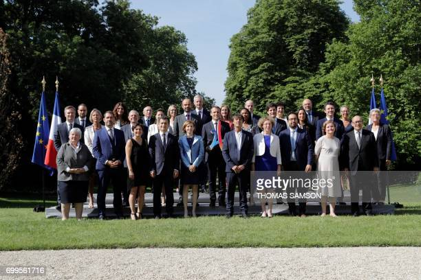 French president Emmanuel Macron poses with the 2024 Olympic's logo with the members of the governement French Secretary of State in charge of...