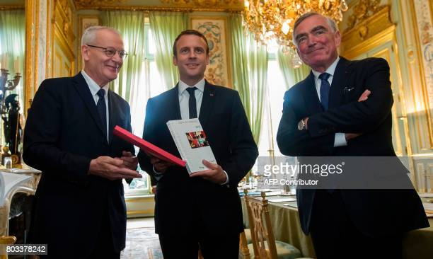 French President Emmanuel Macron poses with the Magistrature council president JeanClaude Marin and President of the Court de Cassation appeals court...