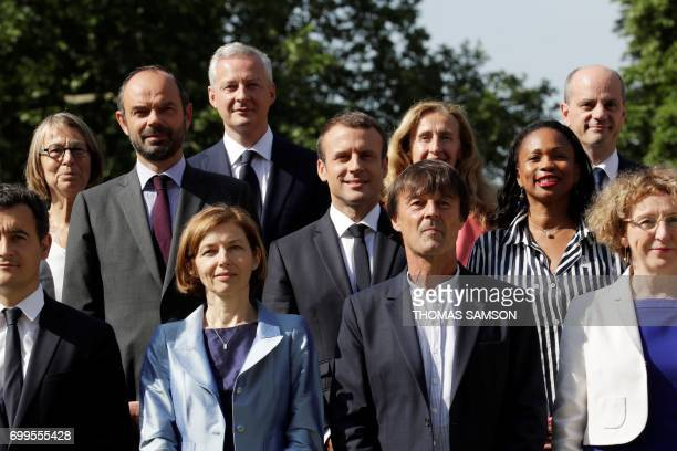 French president Emmanuel Macron poses with the members of the governement Minister of Culture Francoise Nyssen Minister of Economy Bruno Le Maire...