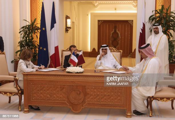 French President Emmanuel Macron Qatari Emir Sheikh Tamim bin Hamad alThani watch French Defence Minister Florence Parly and her Qatari counterpart...