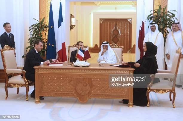 French President Emmanuel Macron Qatari Emir Sheikh Tamim bin Hamad alThani watch France's ambassador to Qatar Eric Chevallier and Sheikha Hind bint...