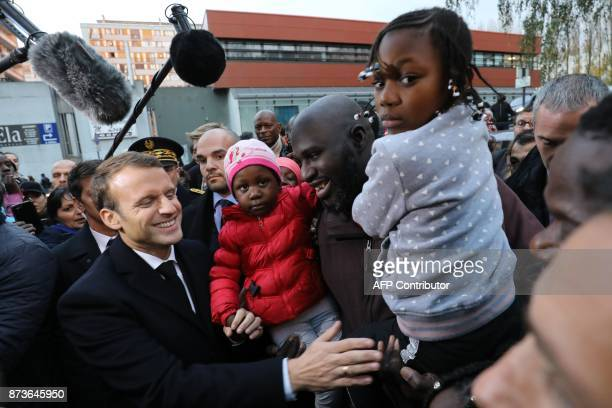 French President Emmanuel Macron reacts as he meets residents of the Cite du Chene pointu during his visit focused on the theme of urbanplanning in...
