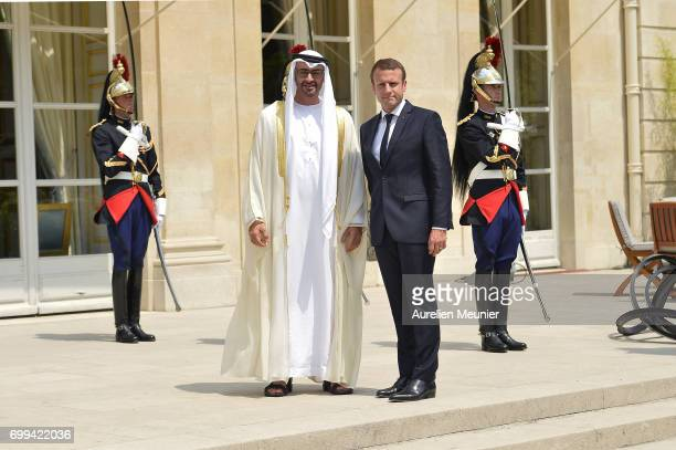 French President Emmanuel Macron receives Abu Dhabi's Crown Prince Sheikh Mohammed Bin Zayed Al Nahyan at Elysee Palace on June 21 2017 in Paris...