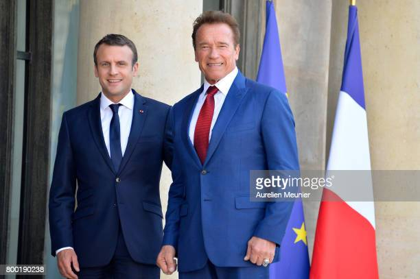French President Emmanuel Macron receives Arnold Schwarzenegger at the Elysee Palace on June 23 2017 in Paris France They discussed the withdraw of...
