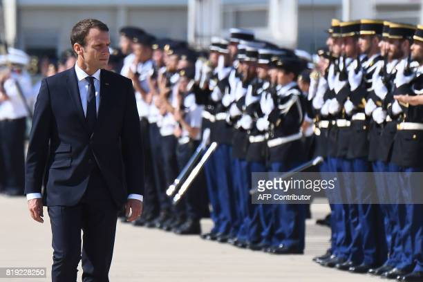 French President Emmanuel Macron reviews an honour guard at an air force base in Istres on July 20 2017 French President Emmanuel Macron will deliver...