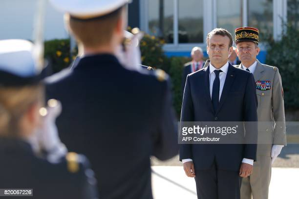 French President Emmanuel Macron reviews troops with French Chief of the military Staff General Pierre de Villiers during a visit to the Ile Longue...