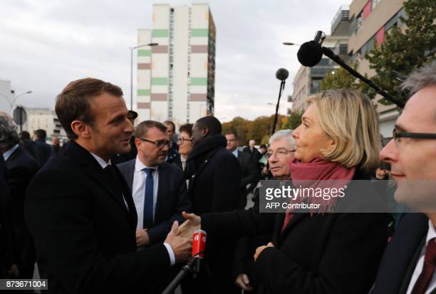 French President Emmanuel Macron shake hands with President of the Regional Council of the IledeFrance region Valerie Pecresse in ClichysousBois...