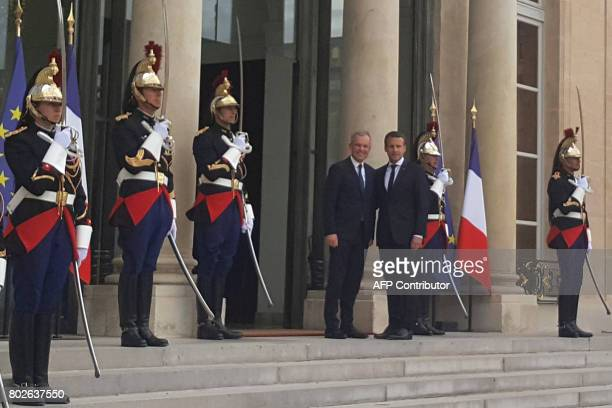 French President Emmanuel Macron shakes hands with French La Republique en Marche party's newly elected President of the National Assembly Francois...