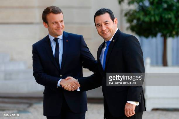 French President Emmanuel Macron shakes hands with Guatemalan President Jimmy Morales upon his arrival at the Elysee palace on June 8 2017 in Paris /...