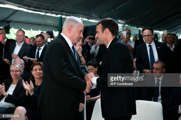 French President Emmanuel Macron shakes hands with Israeli Prime Minister Benjamin Netanyahu during a ceremony commemorating the 75th anniversary of...