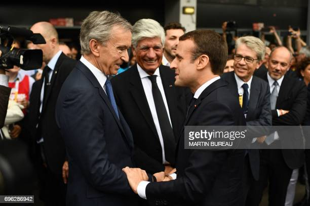 French president Emmanuel Macron shakes hands with LVMH Group CEO Bernard Arnault as he arrives at the Viva technology event dedicated to startups...