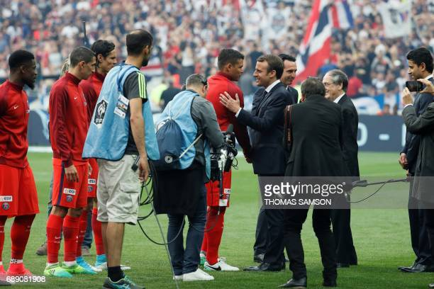 French President Emmanuel Macron shakes hands with Paris SaintGermain's Brazilian defender Thiago Silva prior to the French Cup final football match...