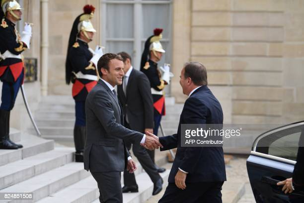 French President Emmanuel Macron shakes hands with Swedish Prime Minister Stefan Lofven upon his arrival at the Elysee Palace on July 31 2017 in...