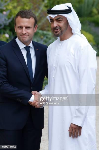 French President Emmanuel Macron shakes hands with The Crown Prince of Abu Dhabi Mohammed bin Zayed al Nayan after meetings at The Elysee Palace in...