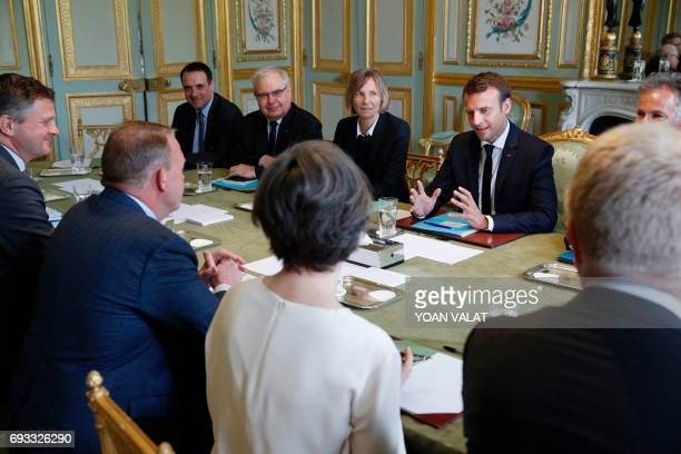 French President Emmanuel Macron speaks next to French Minister of European Affairs Marielle de Sarnez as he meets with Danish Prime Minister Lars...