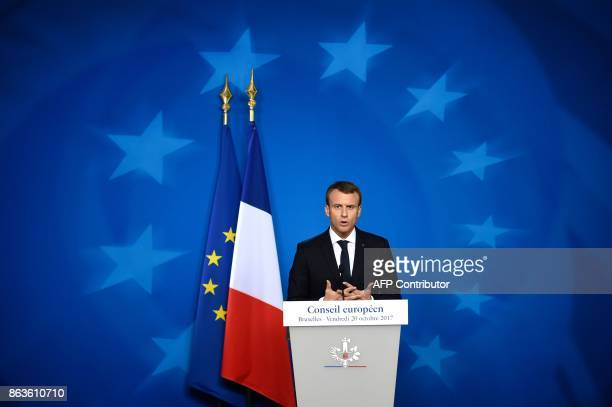 TOPSHOT French President Emmanuel Macron speaks to the press at the end of the EU leaders' summit at the building Council of the EU in Brussels on...