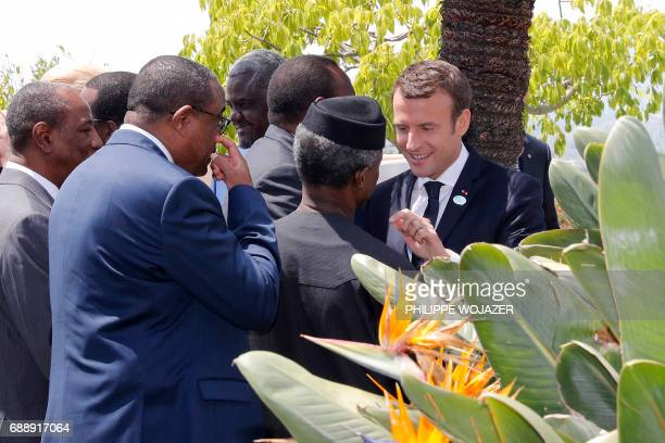 French President Emmanuel Macron speaks with African leaders after an expanded session of the G7 summit during the Summit of the Heads of State and...
