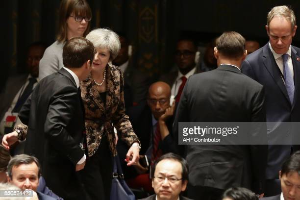 French President Emmanuel Macron speaks with British Prime Minister Teresa May as they participate in an open debate of the United Nations Security...