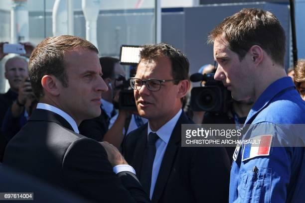 French President Emmanuel Macron speaks with French astronaut Thomas Pesquet at the International Paris Air Show on June 19 2017 in Le Bourget...