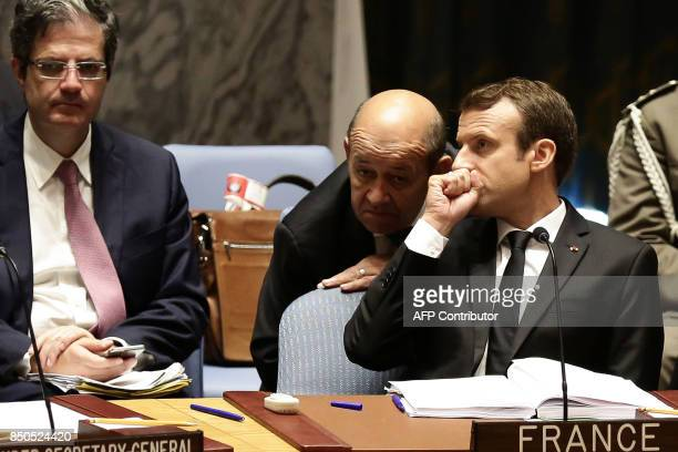 French President Emmanuel Macron speaks with French Foreign Minister JeanYves Le Drian as he participates in an open debate of the United Nations...