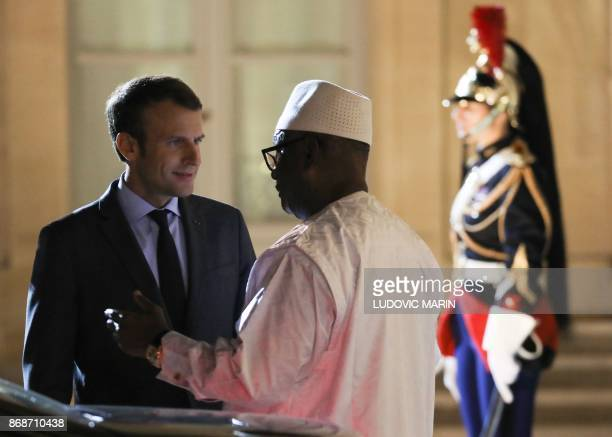 French President Emmanuel Macron speaks with Mali's President Ibrahim Boubacar Keita by his car at the Elysee Palace on October 31 in Paris after...