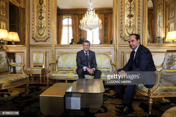 French president Emmanuel Macron speaks with the president of the Union des Democrates Independants party JeanChristophe Lagarde in his office at the...