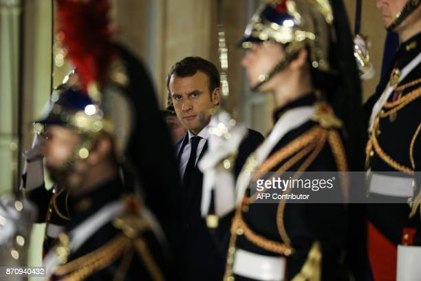 French President Emmanuel Macron standing between Republican Guards looks on after escorting his Cypriot counterpart following their meeting at the...