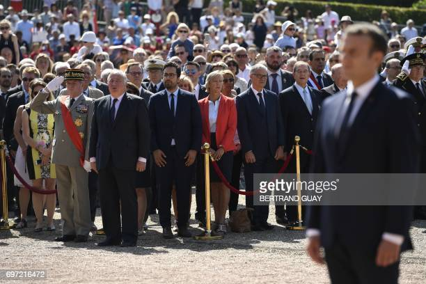 French President Emmanuel Macron stands as French senate president Gerard Larcher French Minister of State for the Digital Sector Mounir Mahjoubi...