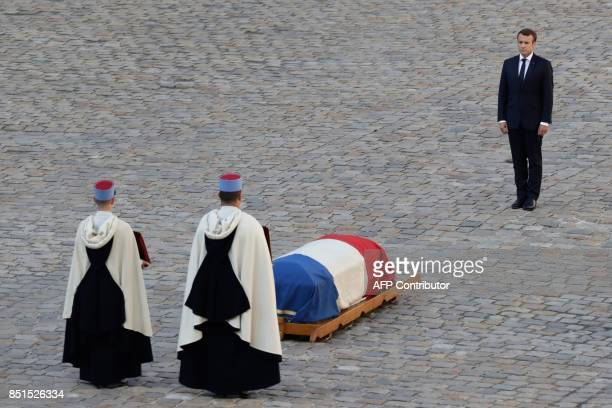French President Emmanuel Macron stands in front of the flagdraped coffin of late French WWII colonel Fred Moore during a ceremony in his honour at...