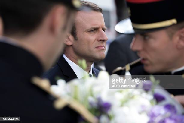 French President Emmanuel Macron stands in front of the Vel d'Hiv Roundup memorial in Paris on July 16 during a ceremony commemorating the 75th...
