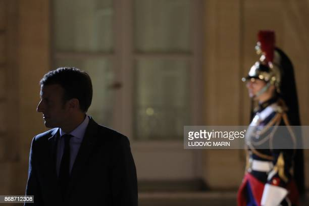 French President Emmanuel Macron stands in the court of the Elysee Palace on October 31 in Paris after a meeting with Malian President / AFP PHOTO /...