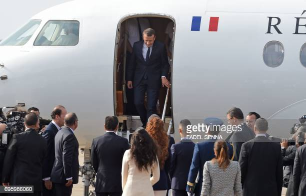 French President Emmanuel Macron steps out of an airplane after landing in Rabat on June 14 2017 Macron is on an official visit to Morocco / AFP...