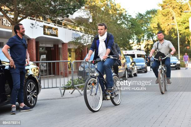 French President Emmanuel Macron takes a bicycle ride on June 10 in Le Touquet northern France the city where Macron votes on the eve of France's...